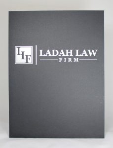 Black linen pocket folder, foil stamped
