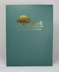 Green linen presentation folder with gold foil